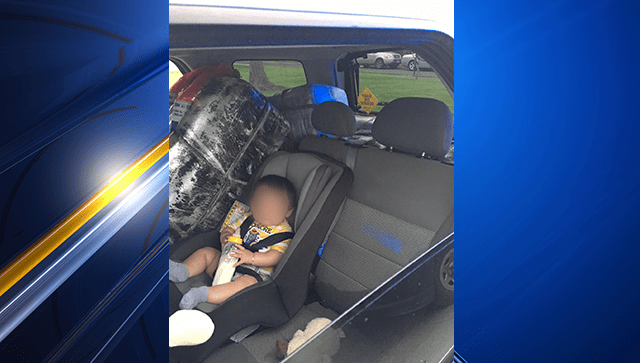 baby in backseat 1_1555105765546.png-3156096.jpg