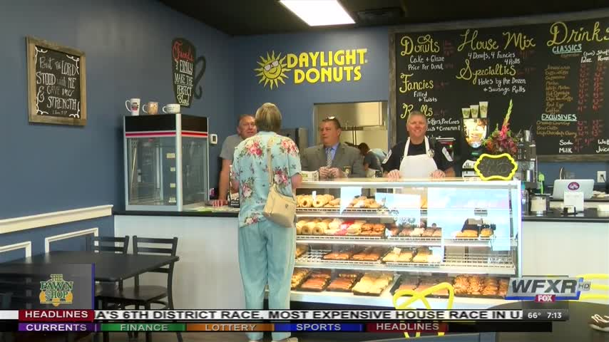 Local law enforcement serves up donuts with a smile_90566541