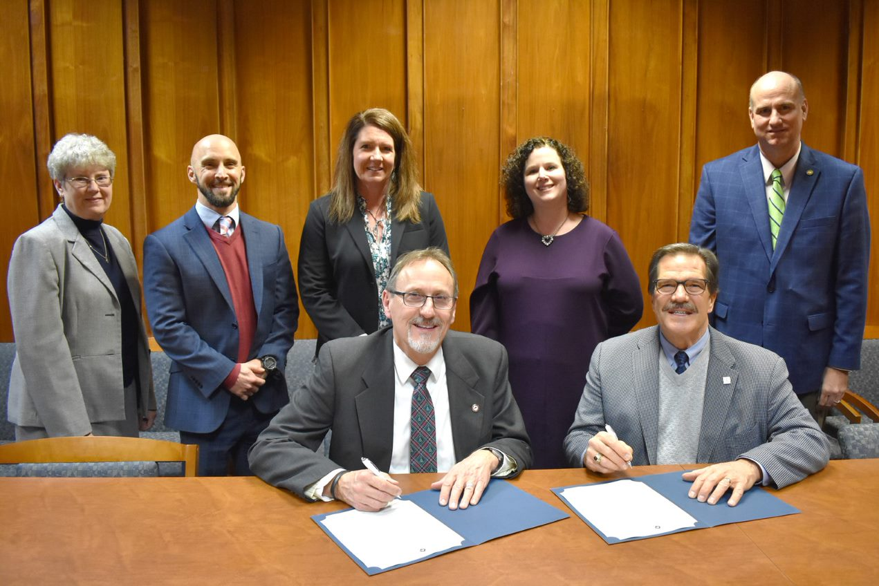 "Representatives from Wytheville Community College and Bluefield College sign the ""Return to Roots Teaching Initiative."