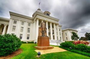 A photo of a building and statue in Montgomery, Alabama.