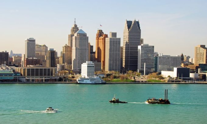 A wide shot of Detroit overlooking the Detroit River.