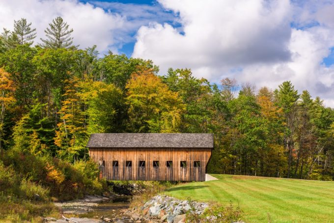Old covered bridge in rural Vermont, USA.