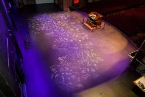 The historic stage at the Mount Baker Theatre was recently covered by patrons' signatures. Photo courtesy: Mount Baker Theatre.