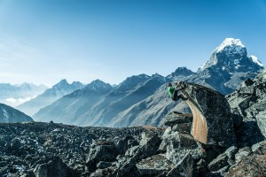 Gabe Rogel captured Peter Doucette hanging off this rock at Ama Dablam base camp in Khumbu, Nepal. Photo credit: Rogel Media.