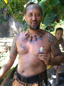 A village chief on the island of Oa Pua in the Marquesas holding Virginia's granddaughter's gnome. Photo courtesy: Virginia Malmquist.