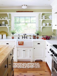 """Pine floors and a butcher block island kept costs down but deliver a charming, homey style that the clients are delighted with,"" Jonathan says. ""The white farmhouse sink is clean and classic. You do not need an huge budget to have a kitchen alive with style."" Photo courtesy: Jonathan O'Brien."