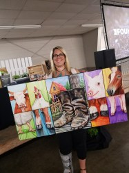 Melissa Bedlington-Kleindel from Dick Bedlington Farms in Lynden was thrilled to win the painting. Photo courtesy: Kevin Coleman.