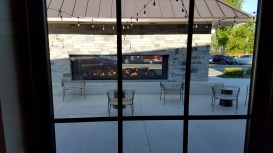 The outdoor fireplace is an exquisite place to gather. Photo credit: Bill Schwartz.