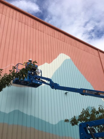 The artists are working long days while they have breaks in the weather to get the project done. Once complete, it will be the largest mural in Washington State. Photo courtesy: Nick Hartrich.