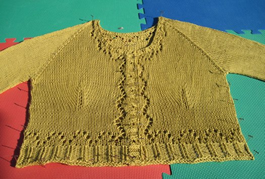 Eyelet sweater being blocked