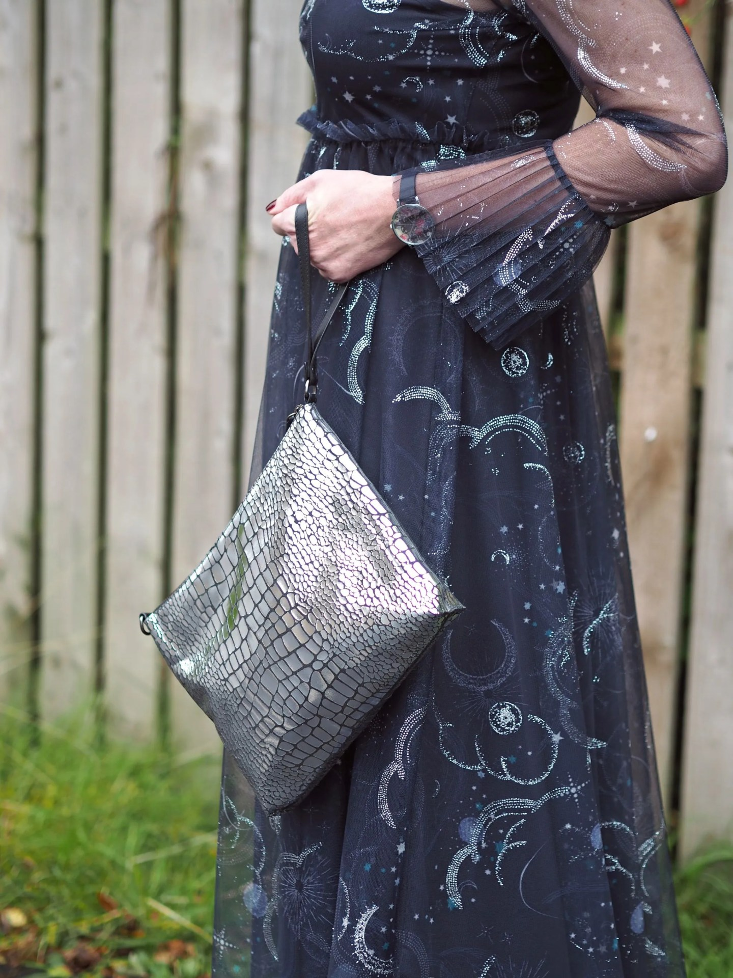what lizzy lovesmarks and spencer constellation midi dress birthday outfit silver metallic clutch wristlet