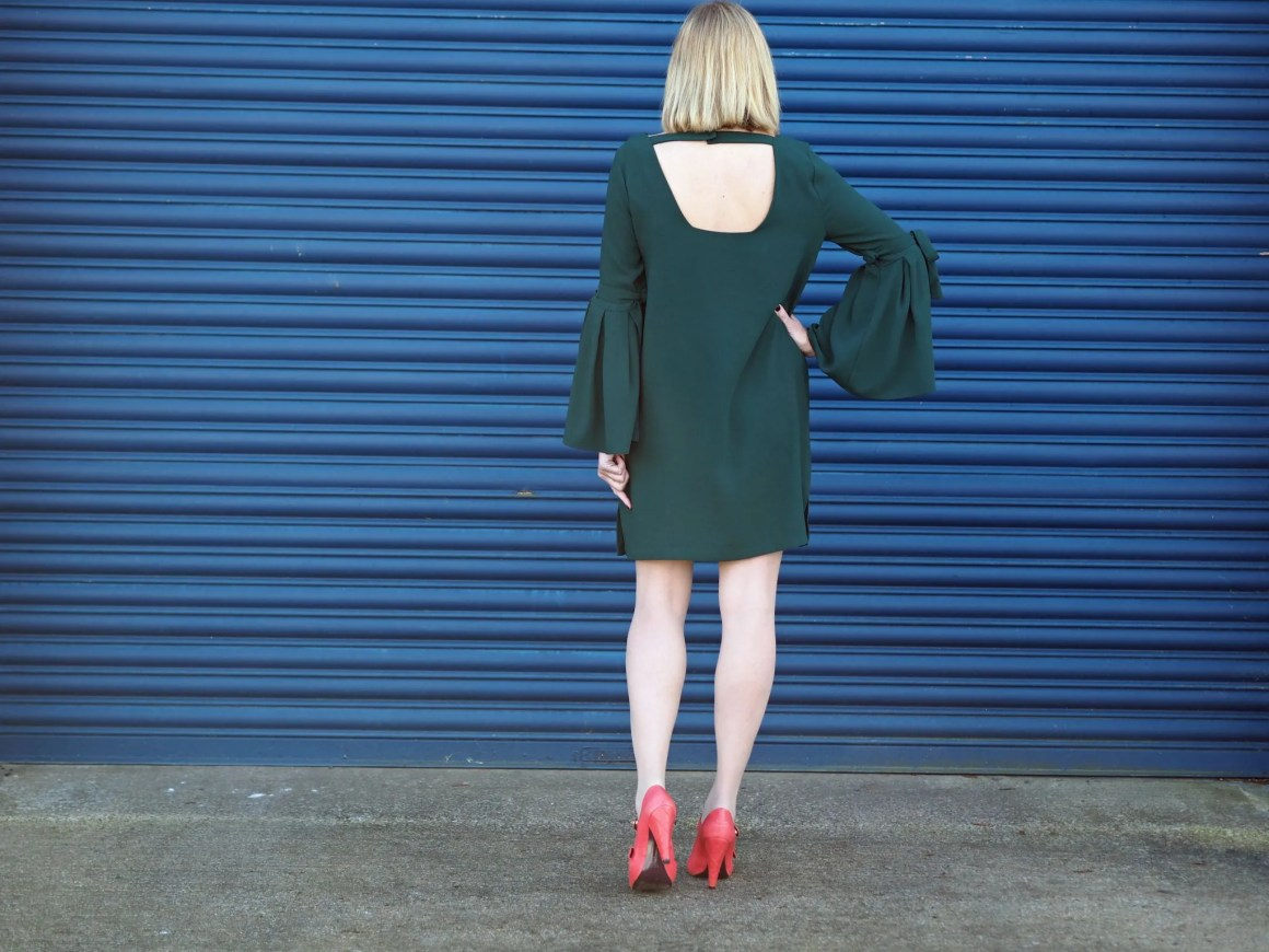 What Lizzy Loves easy party look green dress rainbow Swarovski crystal jewellery back view