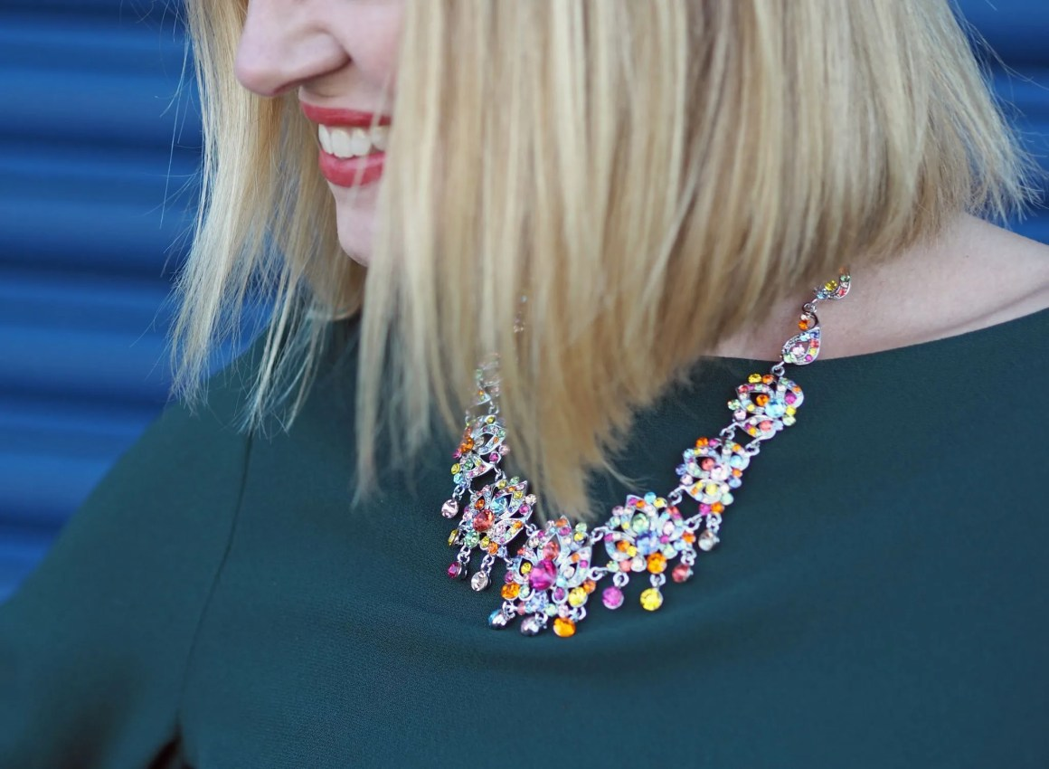 What Lizzy Loves easy party look green dress rainbow Swarovski crystal statement necklace