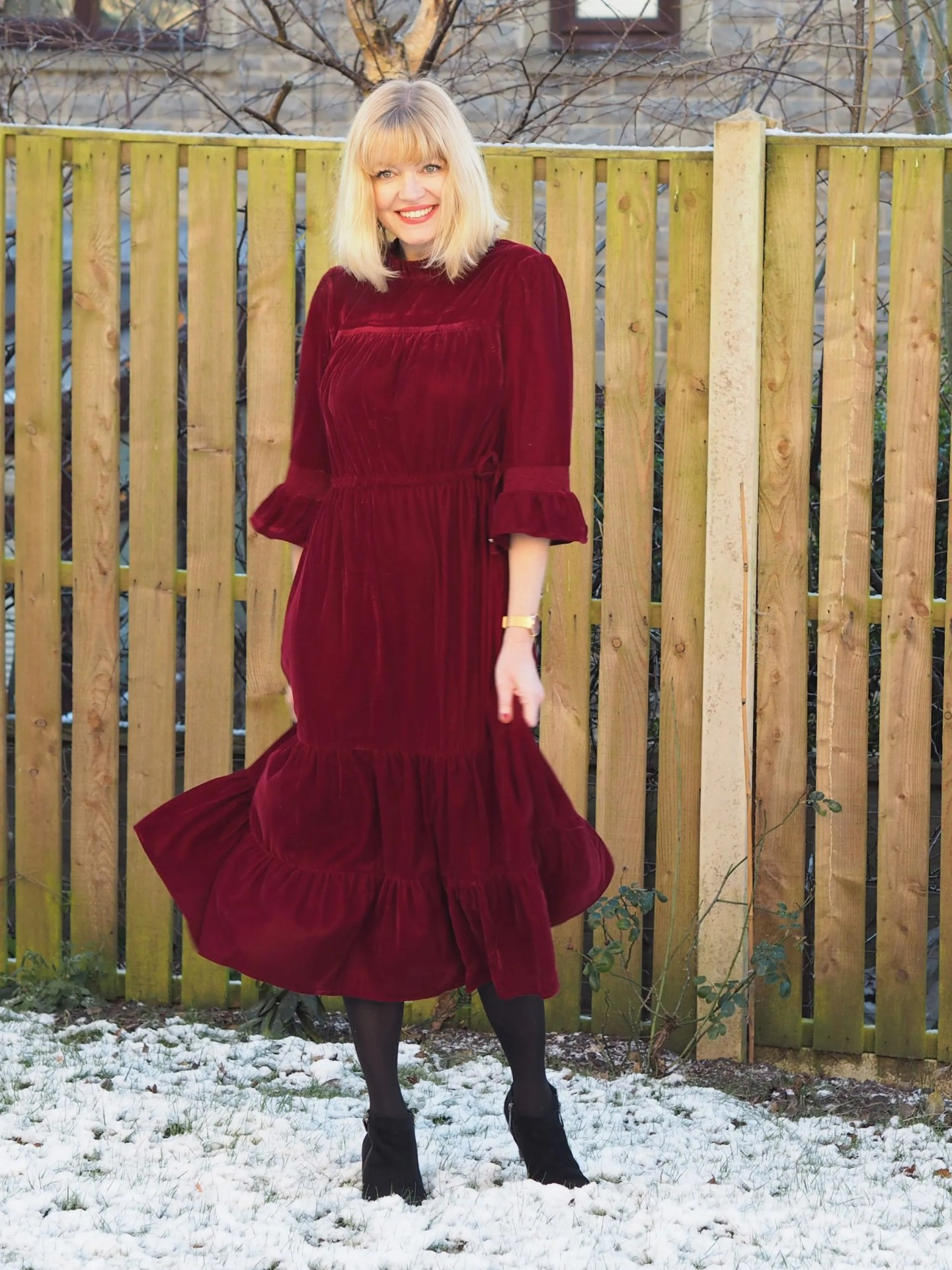 What Lizzy Loves red velvet midi dress and black ankle boots in snow