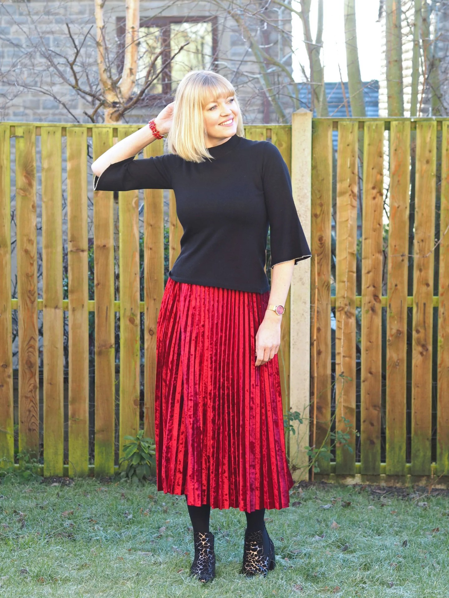 What Lizzy Loves black fluted edge top and red velvet pleated skirt metallic ankle boots