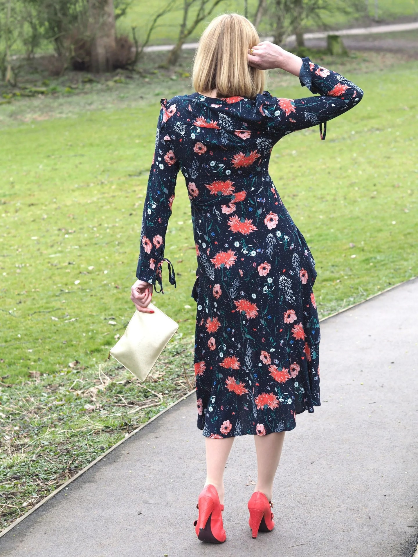 what lizzy loves ears floral midid dress with orange shoes and gold pouch