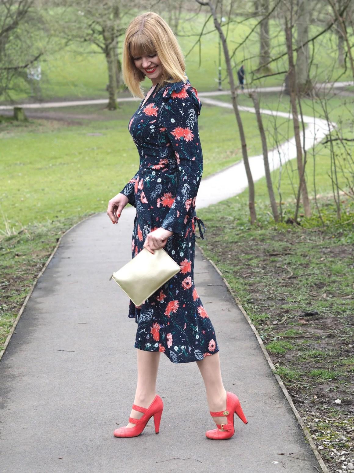 what lizzy loves wears floral midi dress and orange Mulberry shoes
