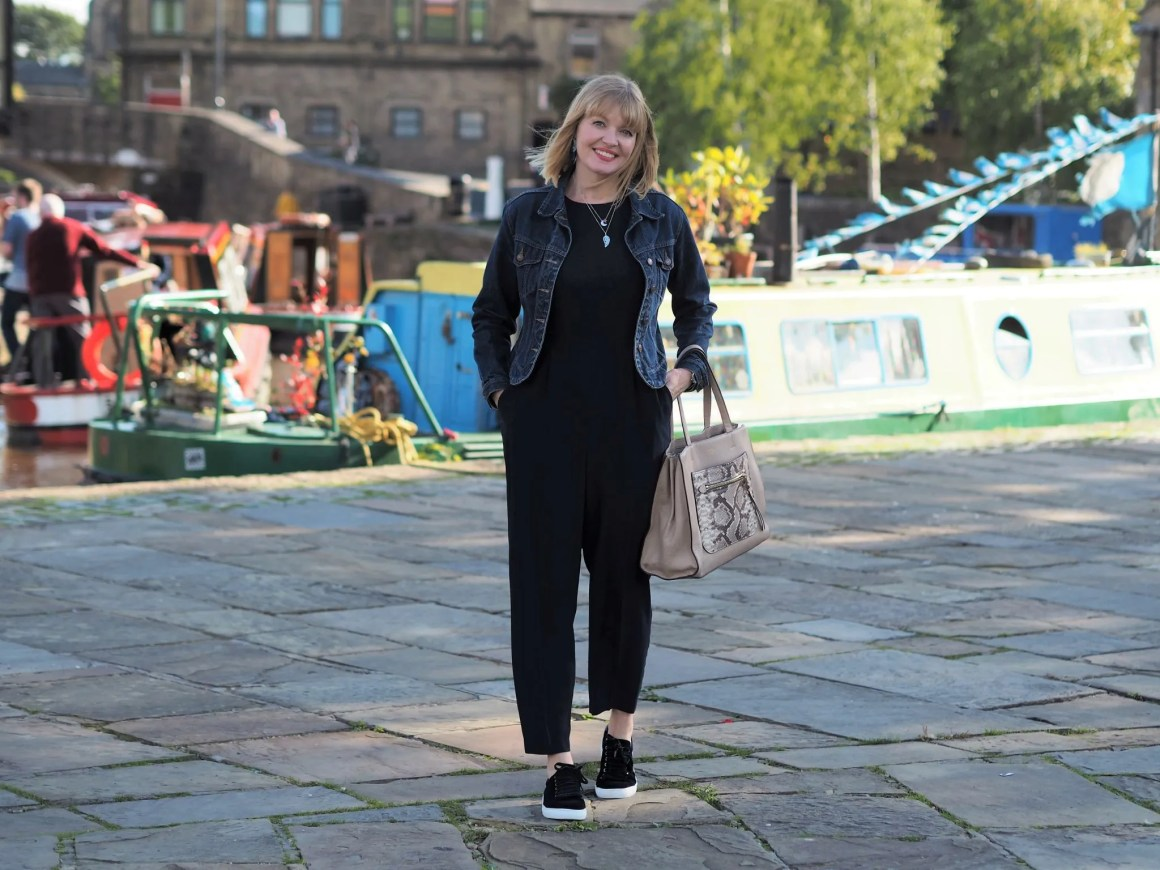hobbs navy jumpsuit with denim jacket and navy velvet trainers