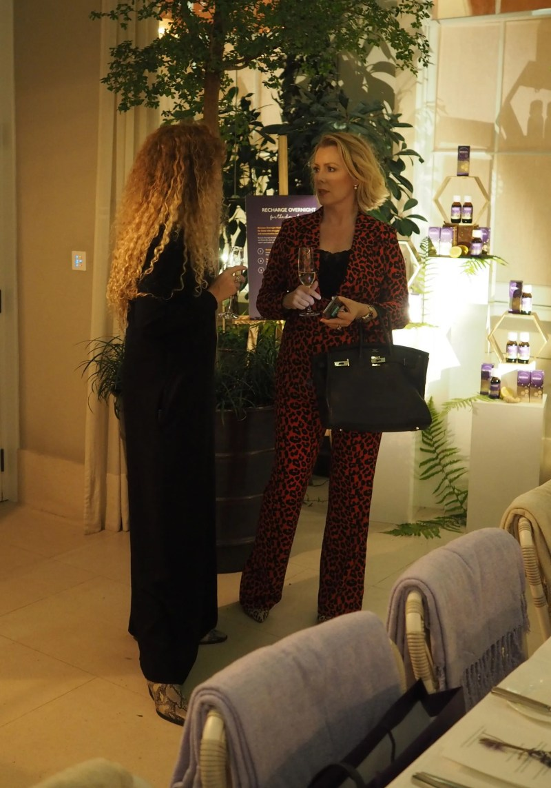 The Sequinist red trouser suit