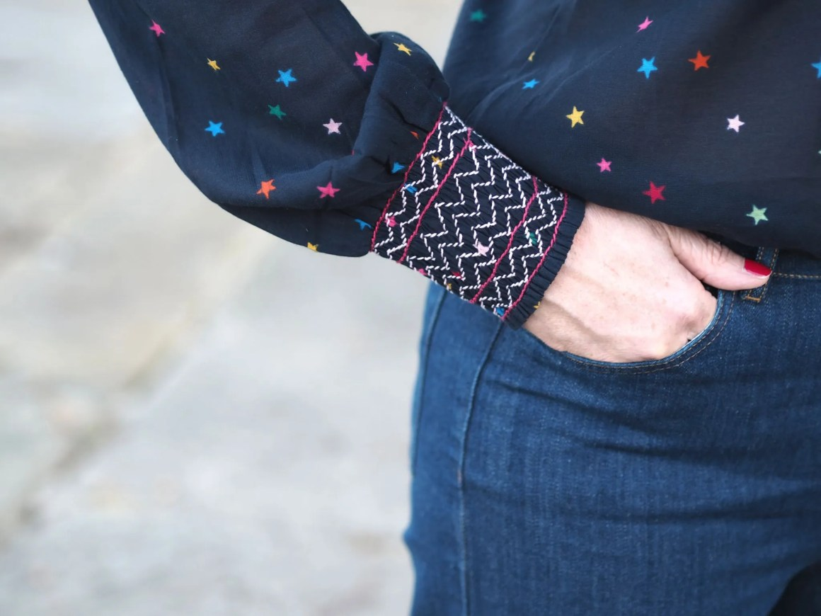 multi-coloured star top sleeve detail