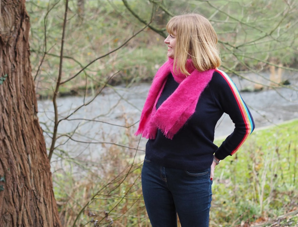 Blogger Lizzy wears rainbow sleeve jumper skinny jeans and pink mohair scarf