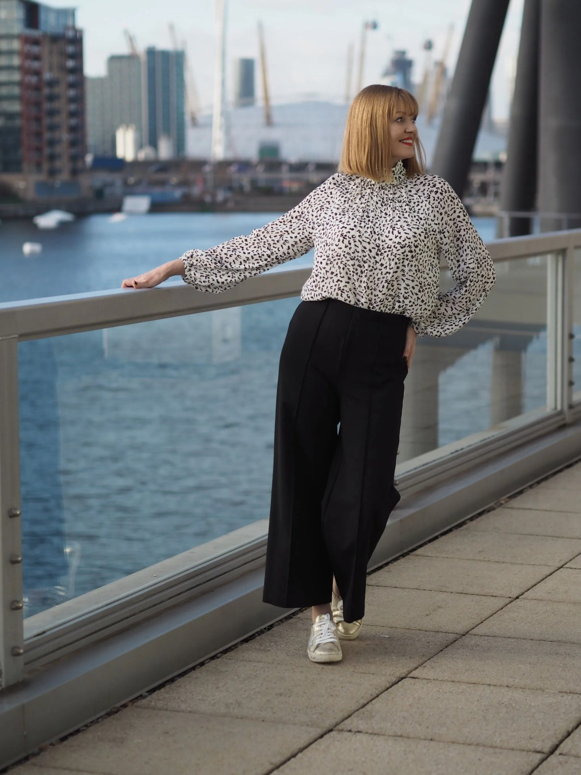 what lizzy loves wears snow leopard print top with black ponte trousers in business and pleasure outfit