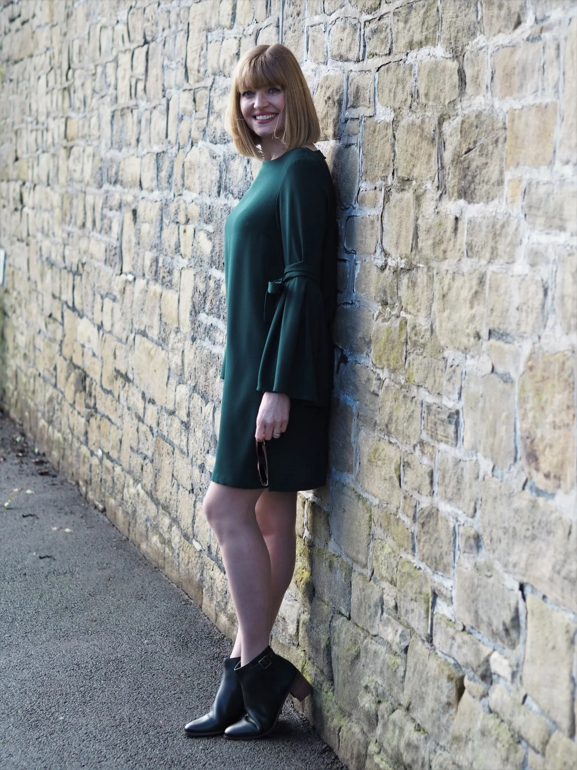 green dress and green leather ankle boots