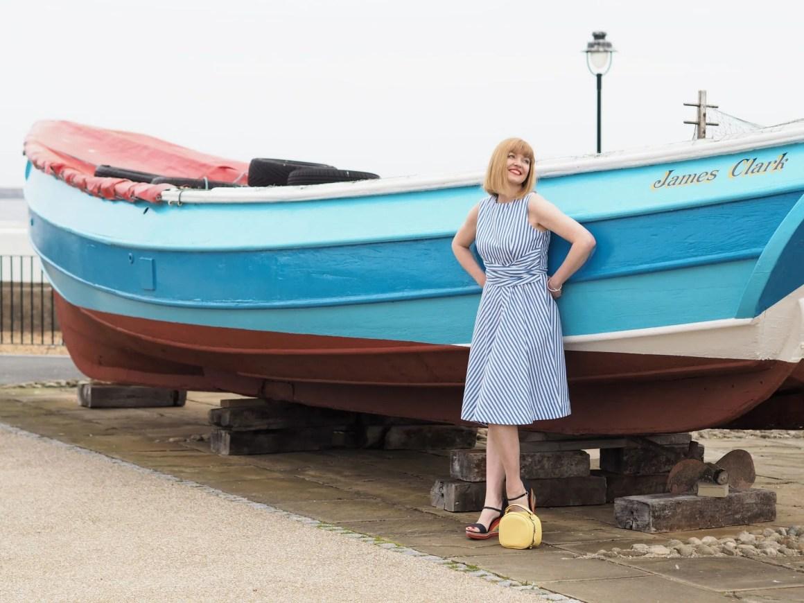 Blue striped 1950s style dress and yellow handbag