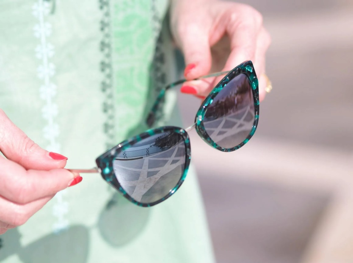 greem embroidered beach dress and green cat eye sunglasses