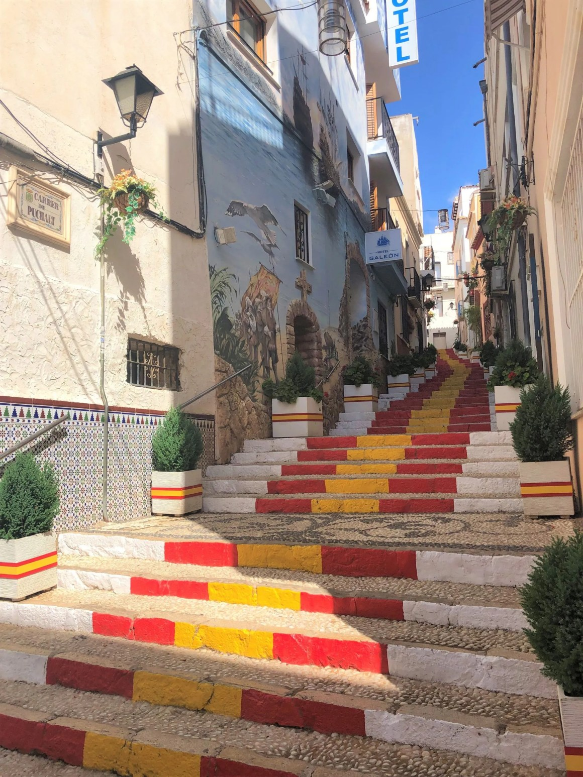 red and yellow painted steps in Calpe