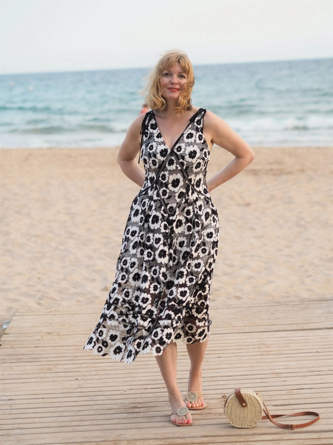 self portrait black and white dress styled casually on the beach