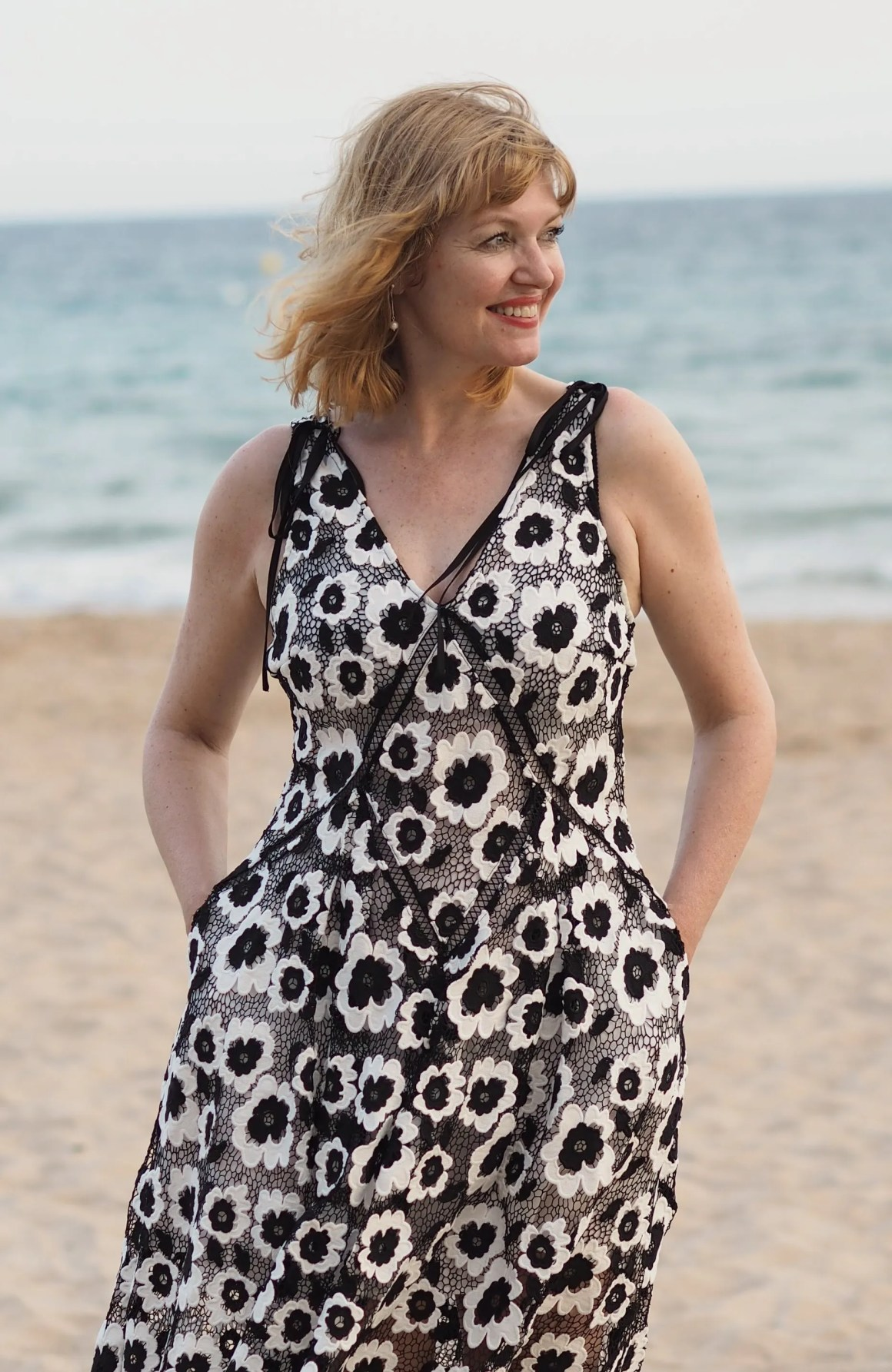 self portrait black and white dress styled casually for the beach