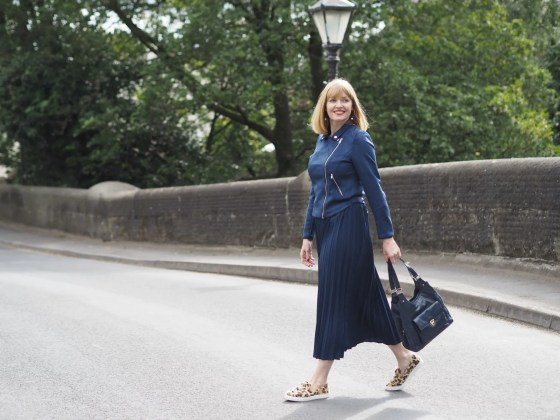 transitional dressing in navy skirt, jacket and shoes