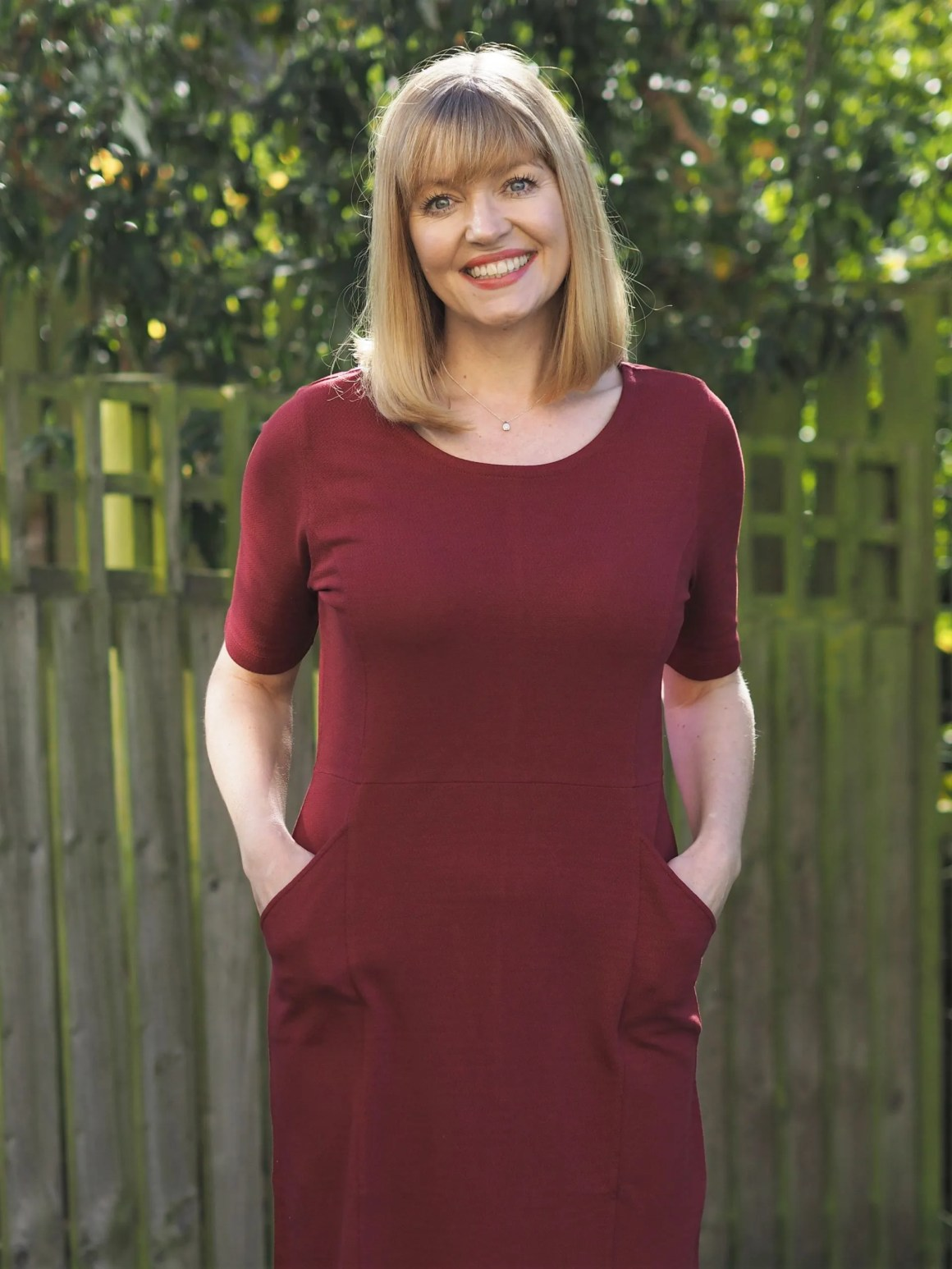 burgundy short-sleeved shift dress with pockets