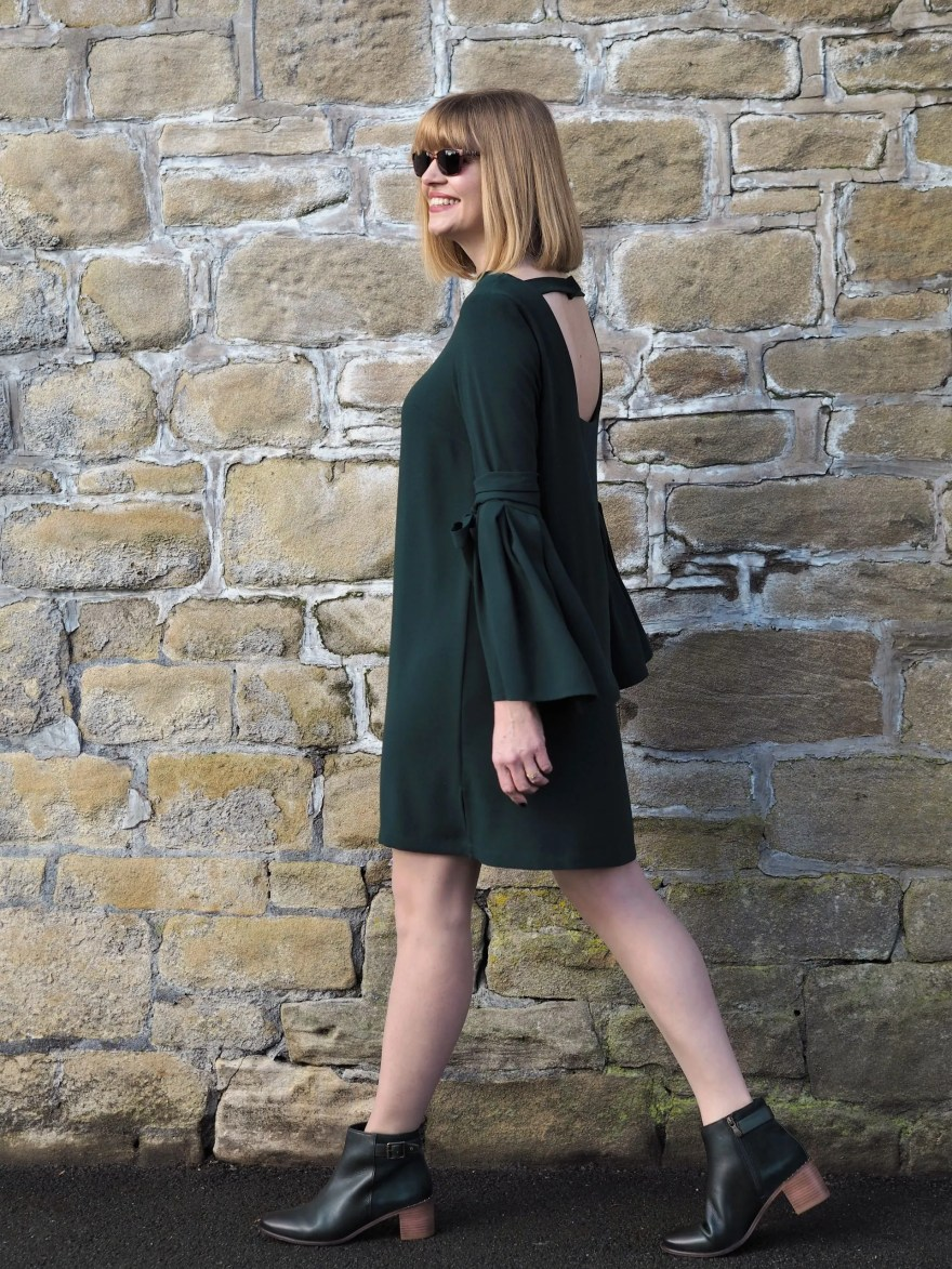 green dress and green ankle boots