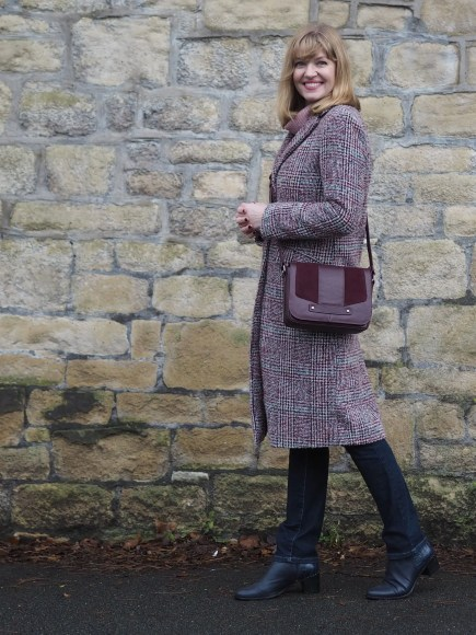 burgundy tweed coat, pink sweater and jeans