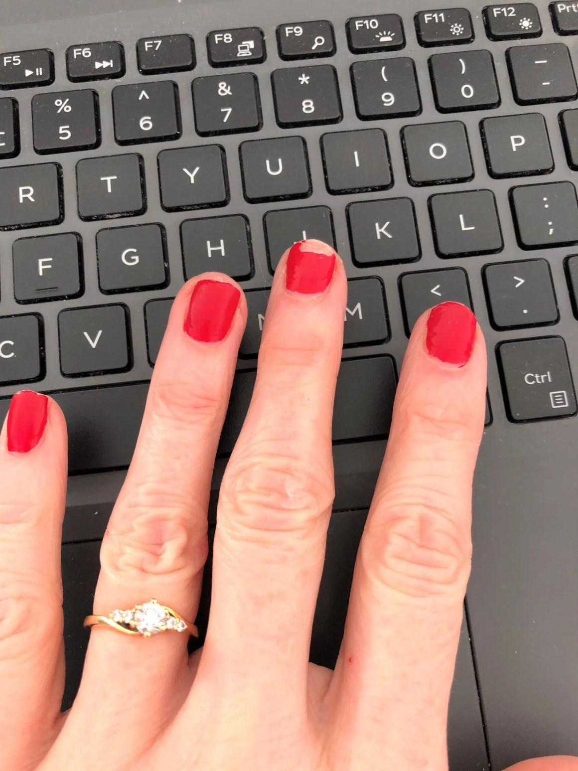 red chipped nail polish