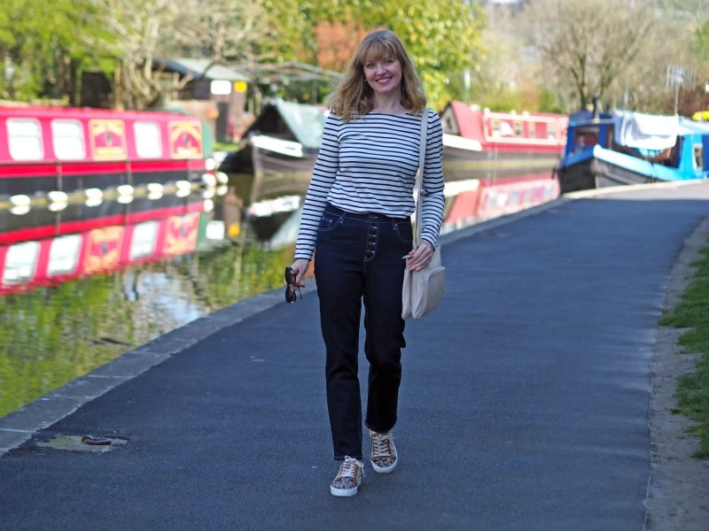woman wearing Breton top and high waisted jeans