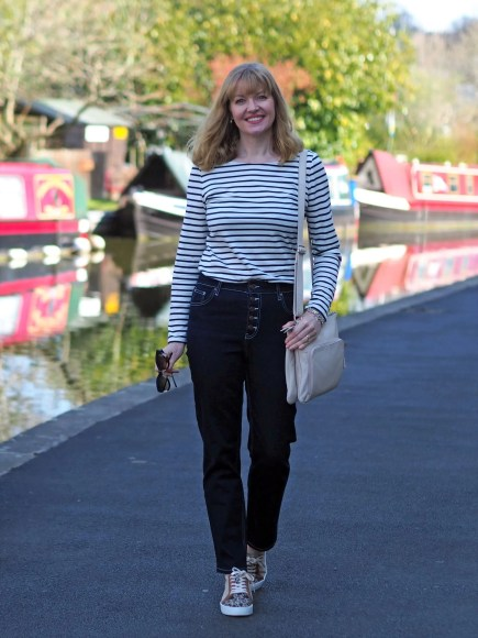 woman in striped top and jeans