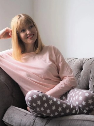 woman wearing star leggings and pink top