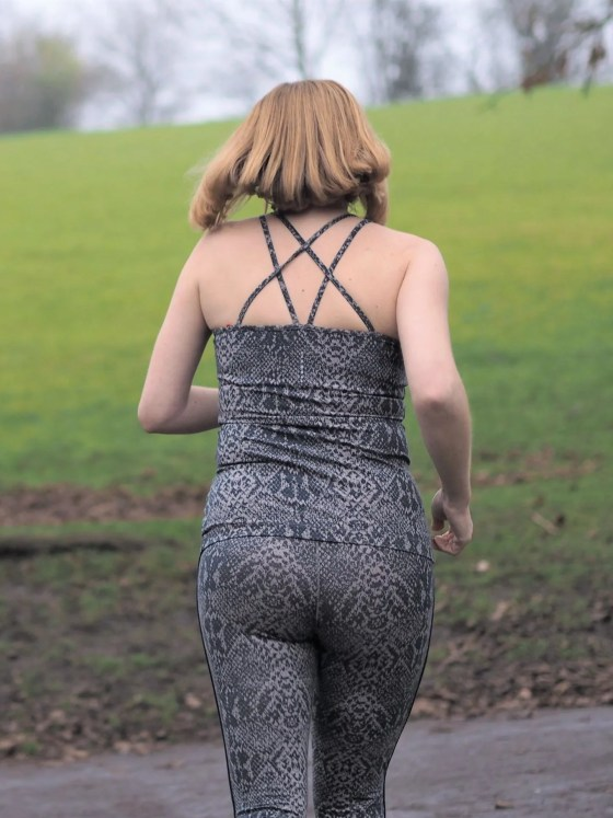 back view of woman jogging