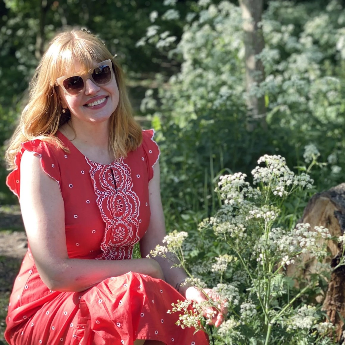 woman sitting among cow parsley