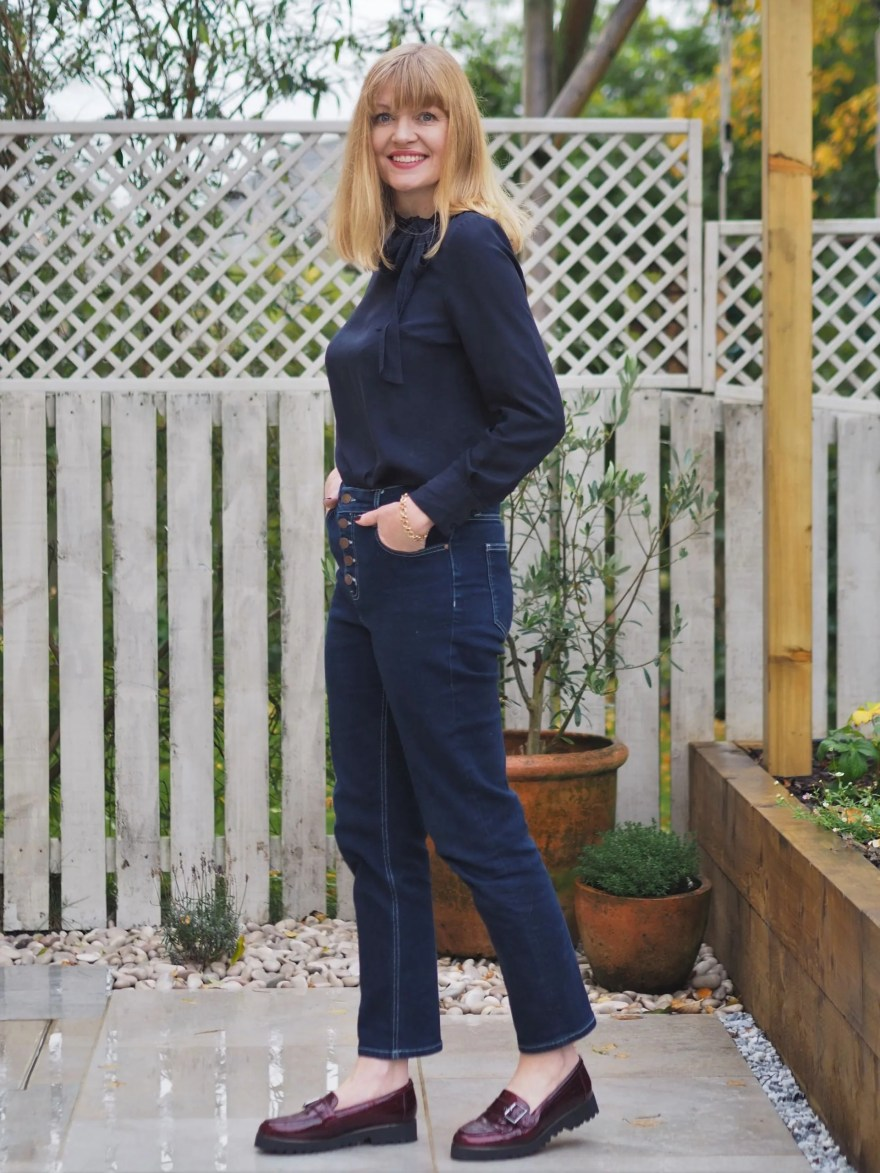 navy silk blouse and jeans outfit