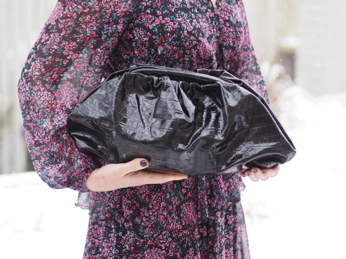 oversized black faux reptile clutch bag