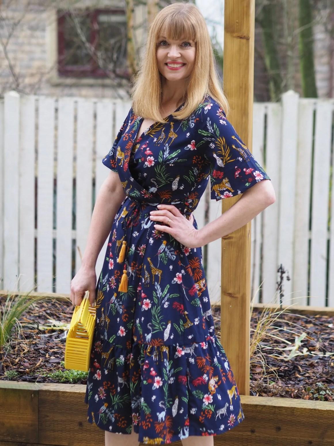 safari print wrap dress with handmade wooden bag