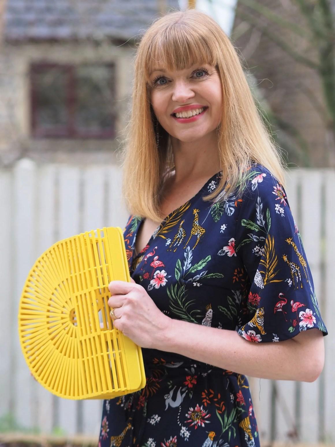 yellow woodwn handbag semi-circular shape