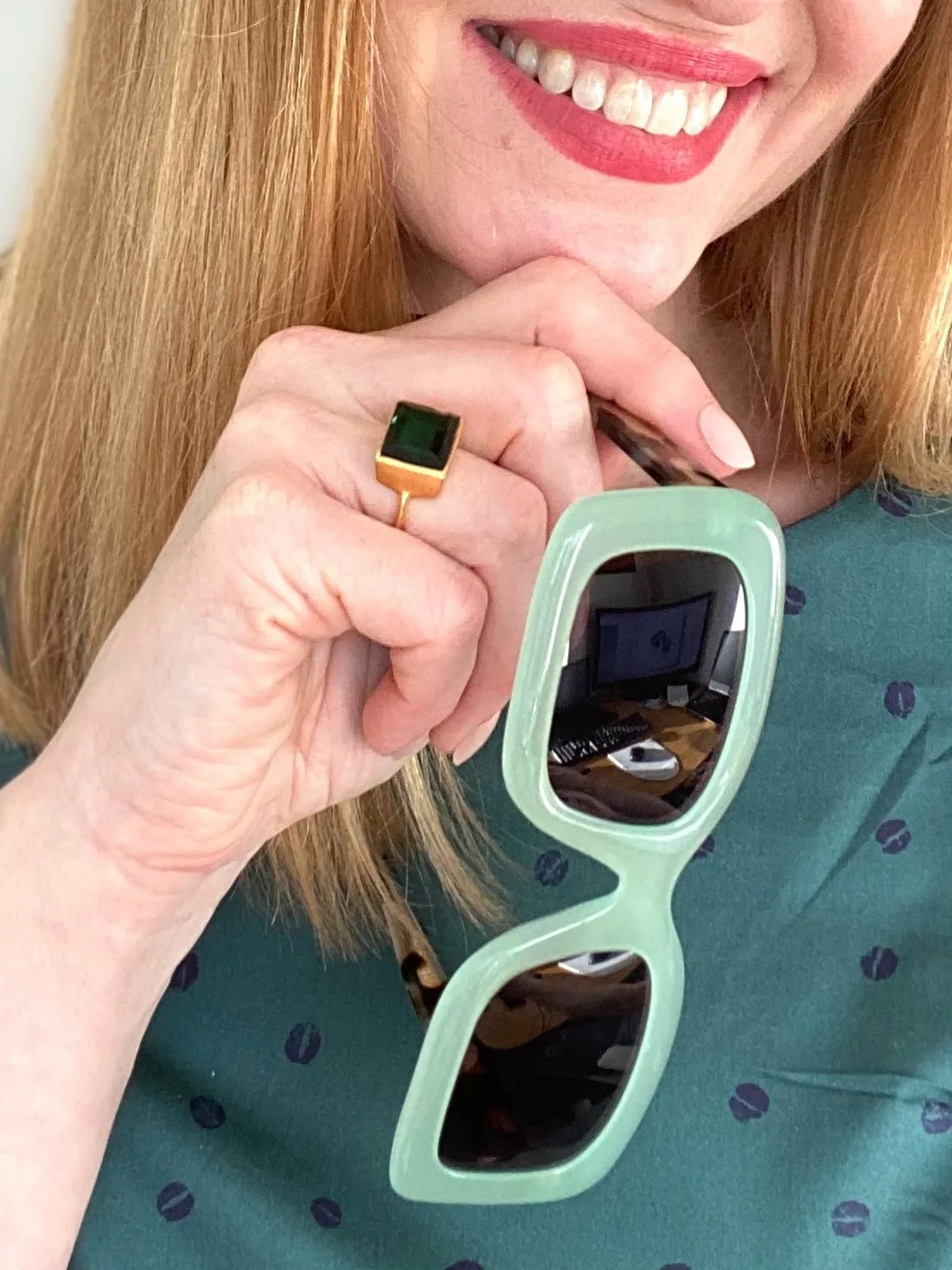 Green midcentury style dress with leopard print bag and mint green square sunglasses