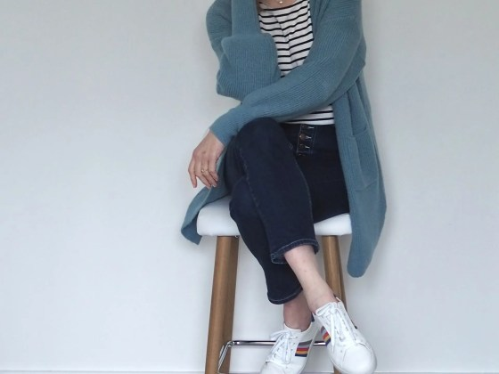 Elizabeth wears breton top, jeans and rainbow trainers