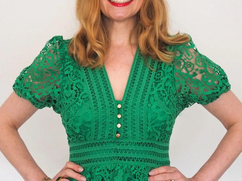 Elizabeth wears green lace cut-work midi