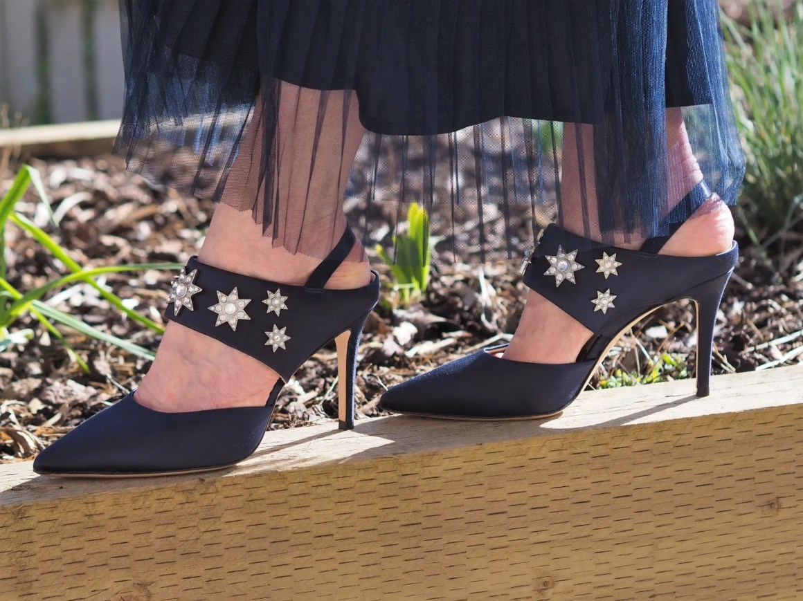 high heel shoes with star embellishment